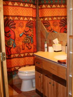 2nd Bathroom- Kokopelli themed w/jetted tub to soak in and wormy maple/walnut cabinets.