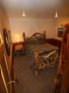Third bedroom Awesome gnarly aspen furniture.  Queen bed/w  pillowtop mattress