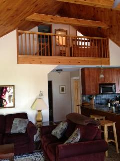 vaulted ceiling in living room and balcony on the second floor