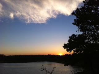 Sunset over Taylors Pond from the cottage deck