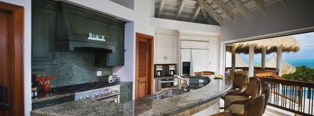 Gourmet kitchen featuring professional-style gas range