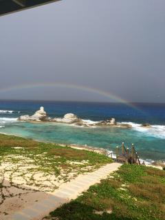 Rainbow over Chimney Rock, your view from villa.