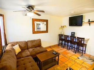 Living room with comfortable seating for 4, flatscreen TV and DVD. Dining bar seats 4 people.