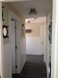 Back hall with full sized washer/dryer