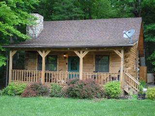 Whitetail log cabin next to Pipestem State Park ALL OUR RATES INCLUDE ALL TAXES