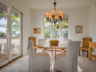 Eat outside on the patio or in this light-filled dining area with a table that seats 6.