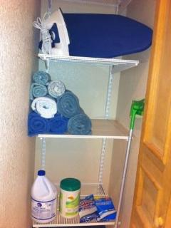 Ironing table, iron, towels, linen closet
