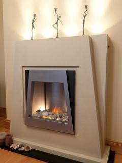Modern electric fireplace with decorative lighting and ornaments