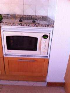 microwave oven and stove