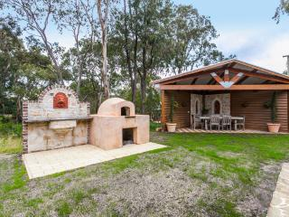 Outsite entertainment area including Gazebo, wood oven and wash basin