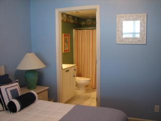 Colorful, adjacent master bath