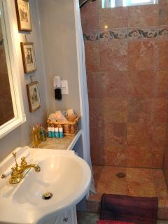 Bathroom with marble tiled shower