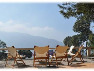 Sun deck out front with views of the Shivalik range
