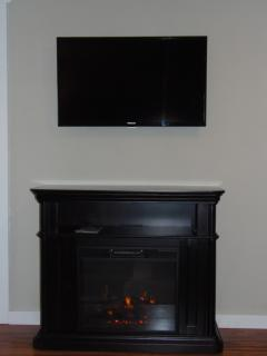 Flat Screen and Electric Fireplace