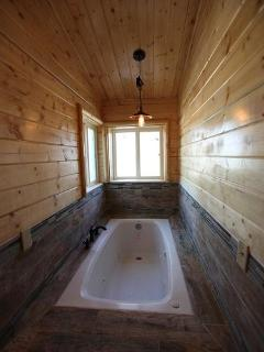 upstairs master bedroom's bathroom jetted tub