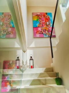 Staircase leading up to Penthouse Suite