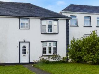 OLD HEAD COTTAGE, open plan living area, two shower rooms, off road parking, close to Blue Flag beaches, near Louisburgh, Ref. 7899