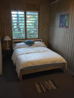 Second room, full bed. Canopy views, feels like sleeping in a tree house.