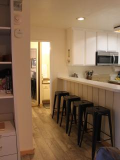 Breakfast bar at kitchen with new stainless steel appliances