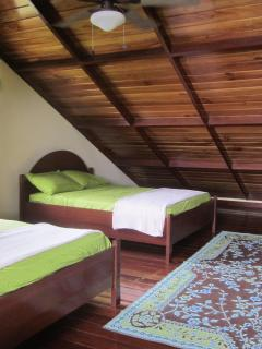 Two double beds in the lofted bedroom