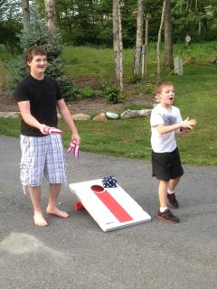 Play a round of corn hole