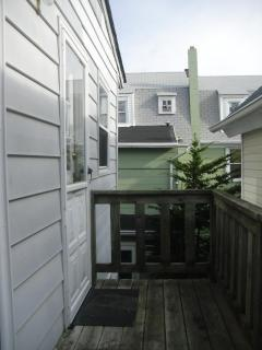 Small deck off bedroom w/ fire escape stairs
