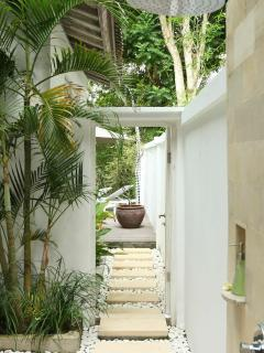 Path to the pool area from the bathroom
