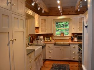 Farm sink; gooseneck faucet, quiet Miele dishwasher; gas LG stove; fully equipped kitchen.