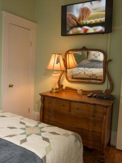 Master bedroom with 40' Samsung HDTV, closet and an antique dresser