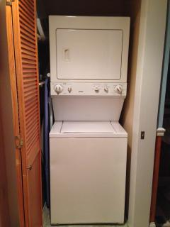 Stacked washer and dryer. Laundry detergent supplied with no dyes or perfumes