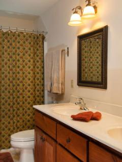 Double sinks in the large bath plus a tub/shower and plenty of soft, fluffy towels for the family.