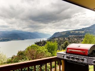Stunning views of the river & Mt Hood from this home w/two decks, game room