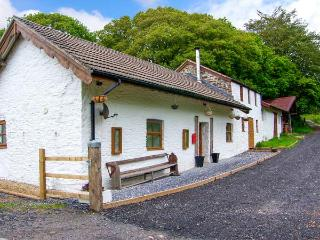 1 BRYNDIAS COTTAGES, mostly ground floor, woodburner, WiFi, parking, garden, in