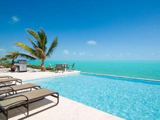 This private, oceanfront villa is situated on the south shore and is surrounded by blue ocean. IE BRE, Leeward