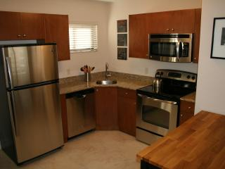 Kitchen has stainless appliances and granite tops