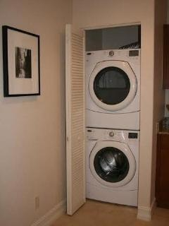 Stacked full size washer and dryer in apartment
