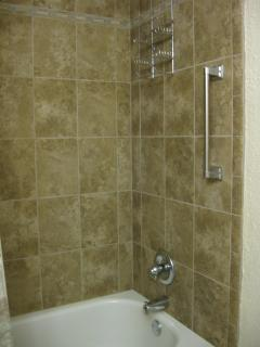 Decorative tile in both newly-remodeled bathrooms