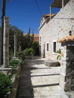 The stone house is situated on a small hill and is full of history.