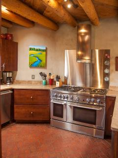 A cook's kitchen with six-burner stove, double-oven and griddle.