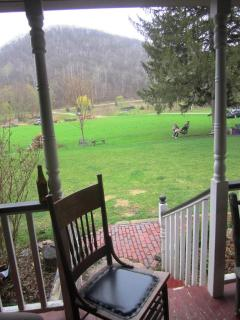 The view from the front porch in early spring, just as things are greening up.