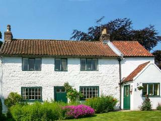 THE WHITE COTTAGE, detached, woodburning stove, parking, garden, in Bridlington,