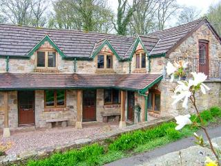 THE BARN, terraced barn conversion, on working farm, parking, in Llangollen