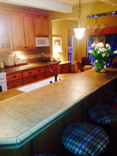 The kitchen is fully updated. The counter seats 4 and the dining room nook seats another 4.