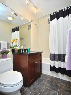 Bathroom with expansive mirror