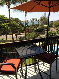 Best of both views - ocean & pool! New bar height chairs, umbrella & lounger!