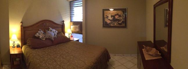 Downstairs bedroom with king bed, new dresser & nightstands and it's own A/C.