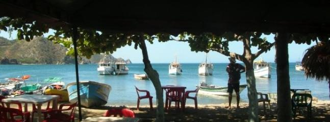 Nearby: Taganga beach: sit, relax and order your lunch.