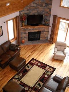 Living room view from upstairs, gas fireplace, mountain views, large screen tv
