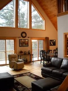 Living room with plenty of seating to enjoy the fire or watching TV with family, beautiful mnt views