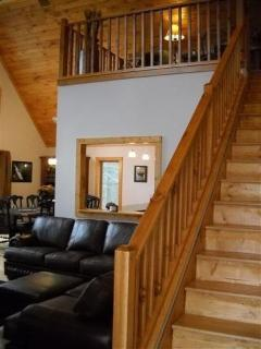 Stairs heading up to master bedroom with sitting loft